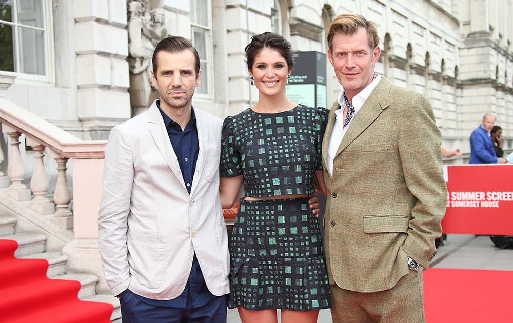 Mel Raido, Gemma Arterton and Jason Flemyng pose for photographers upon arrival at the opening of Somerset House Summer Screen and premiere of Gemma Bovery in London.