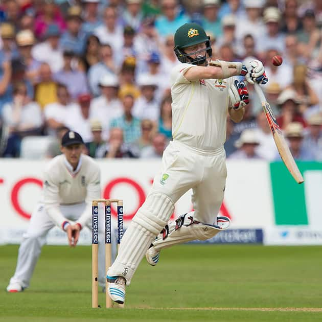 Australia's Chris Rogers hits a catch to Joe Root off the bowling of Mark Wood only to be recalled after the bowler is penalised for a no ball on the second day of the fourth Ashes test cricket match between England and Australia at Trent Bridge cricket ground in Nottingham, England.