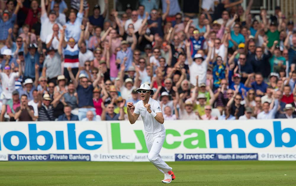 England's Stuart Broad celebrates after catching Australia's David Warner, out for 64 off the bowling of Ben Stokes on the second day of the fourth Ashes test cricket match between England and Australia at Trent Bridge cricket ground in Nottingham, England.
