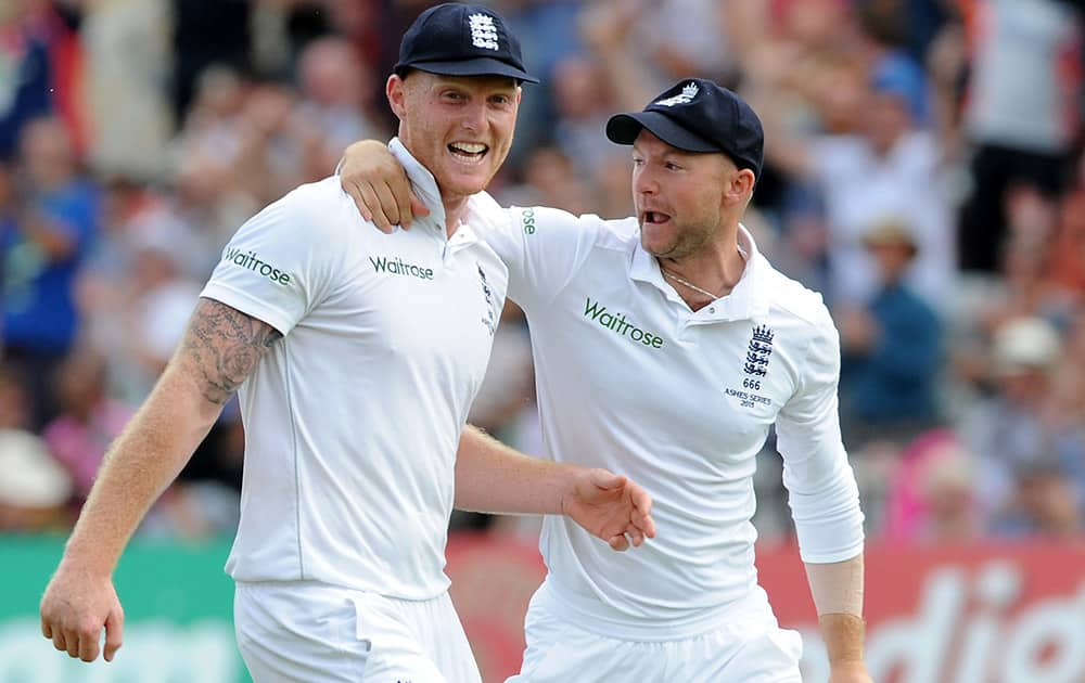 England's Ben Stokes celebrates with Adam Lyth after catching Australia's Steven Smith bowled by England's Stuart Broad caught Ben Stokes for 5 runs during day two of the fourth Ashes Test cricket match, at Trent Bridge, Nottingham, England.