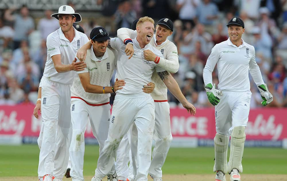 England's Ben Stokes, centre, celebrates with team mates after bowling Australia's Mitchell Johnson caught Alastair Cook for 5 runs during day two of the fourth Ashes Test cricket match, at Trent Bridge, Nottingham.