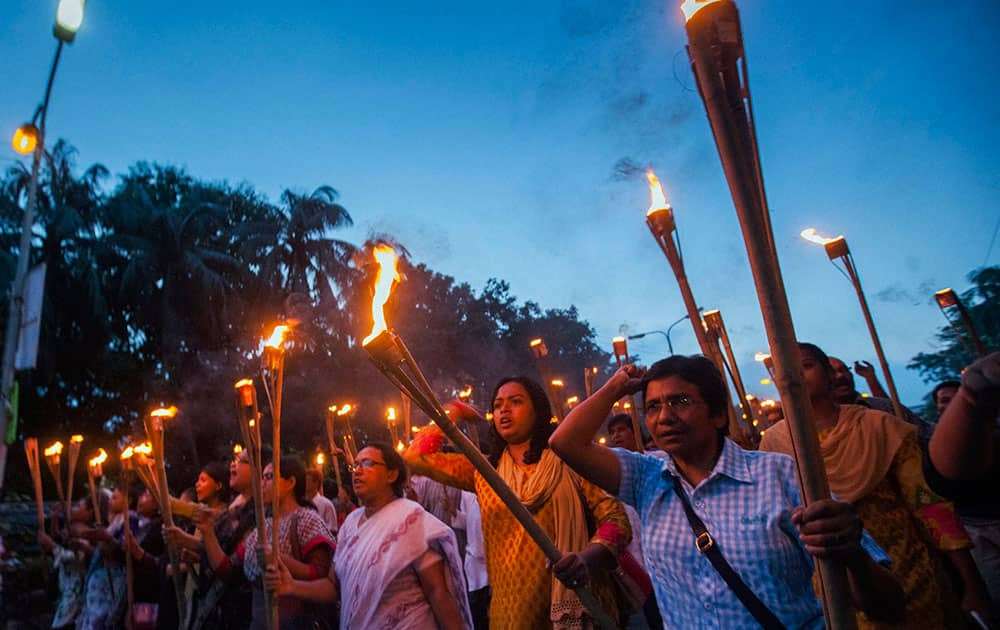 Bangladeshi secular activists participate in a torch rally held to protest against the killing of blogger Niloy Chottopadhay, 40, in Dhaka, Bangladesh.