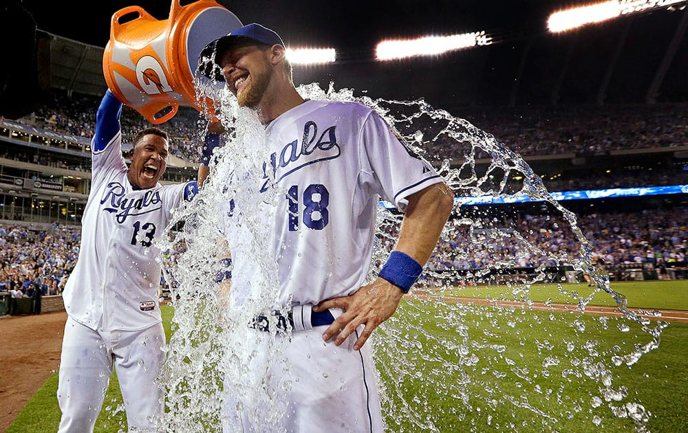 Kansas City Royals' Ben Zobrist (18) is doused by Salvador Perez after a baseball game against the Chicago White Sox in Kansas City, Mo.