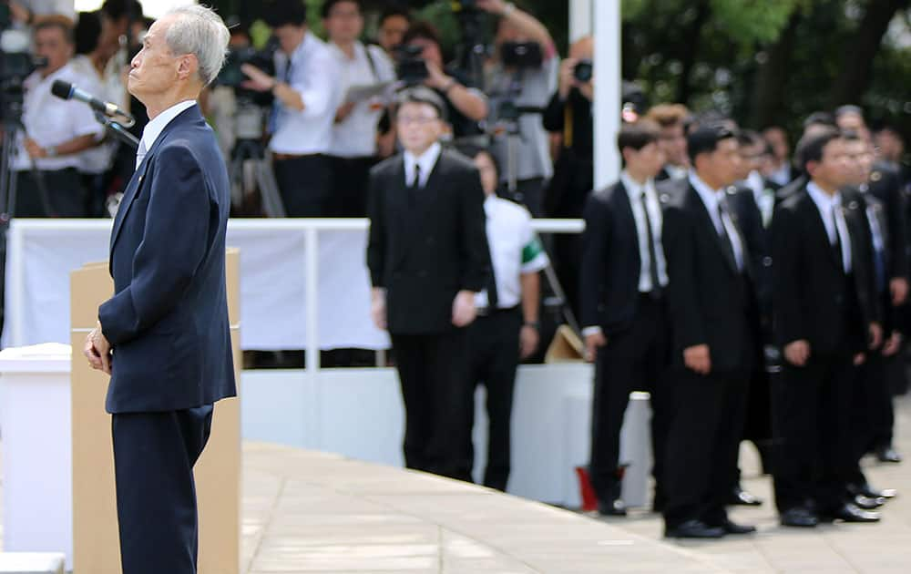Sumiteru Taniguchi, 86, a survivor of the 1945 atomic bombing of Nagasaki, pauses before delivering his speech at the 70th anniversary of the atomic bombing in Nagasaki.