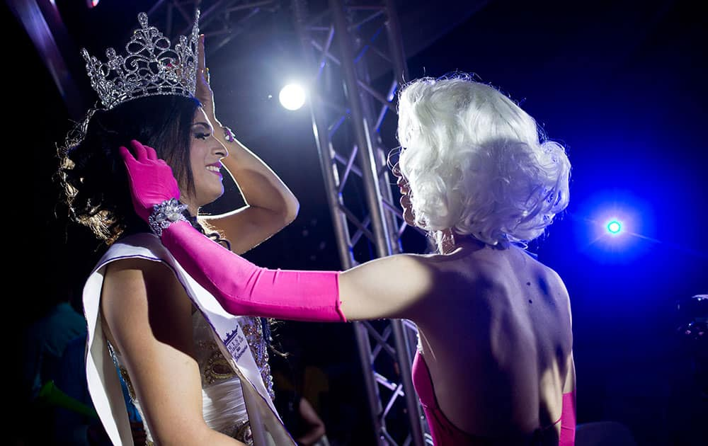 Gabriel Blandon, 25, left, is congratulated by April Montero after winning the 2015 Miss Gay Nicaragua beauty contest in Matagalpa, Nicaragua.