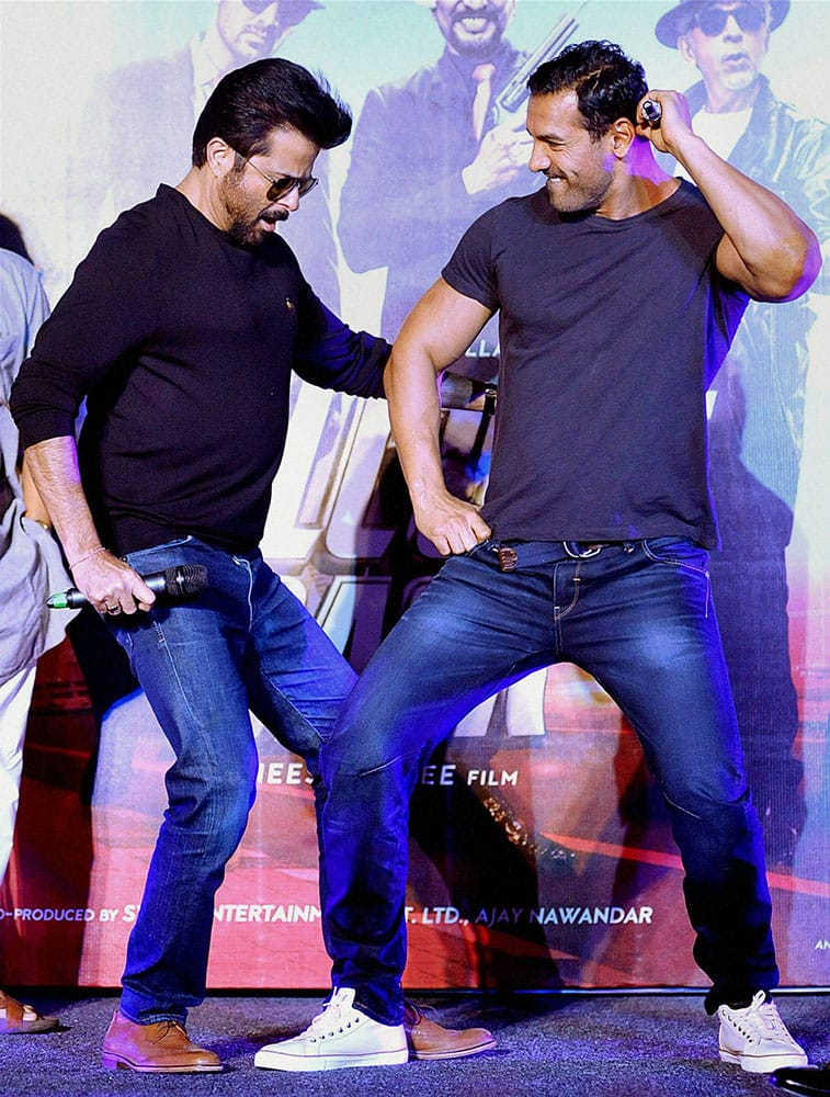 Bollywood Actors Anil Kapoor and John Abraham dance during the promotion of their upcoming Hindi film 'Welcome Back' directed by Anees Bazmee, in Mumbai.