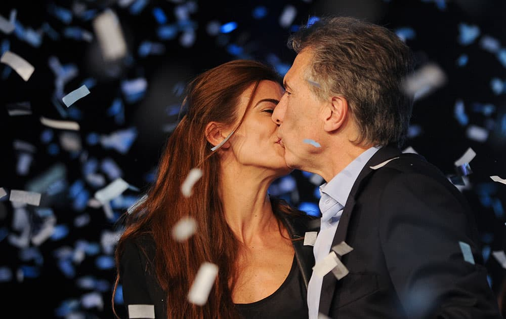 Outgoing mayor of Buenos Aires and top opposition presidential candidate Mauricio Macri , right, kisses his wife Juliana Awada after the primary elections in Buenos Aires, Argentina.