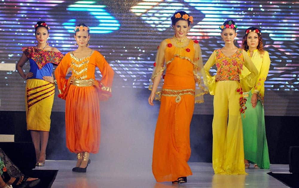 Models walk the ramp at a fashion show in Dibrugarh.