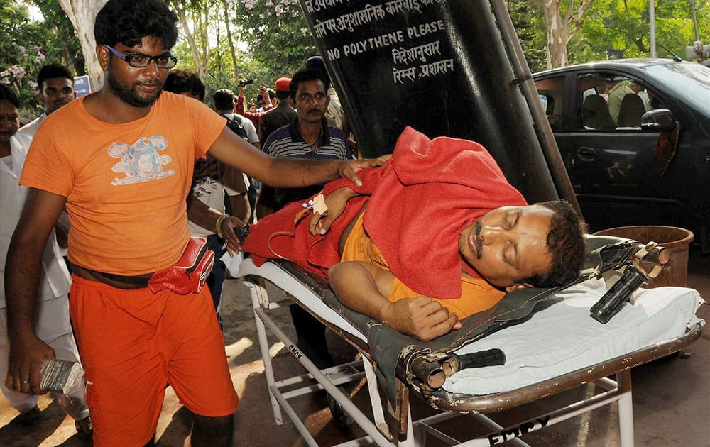 Injured being taken to a hospital after a stampede at Baba Baijnath Dham Temple in Deoghar on the second Monday of the holy month of Shravan.