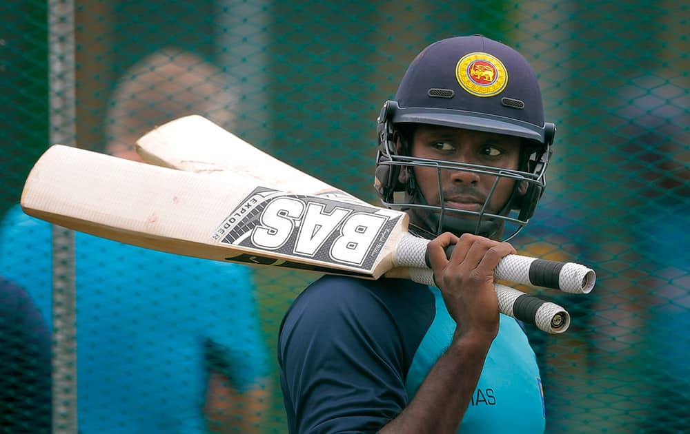 Sri Lanka's captain Angelo Mathews attends a practice session ahead of the first test cricket match against India in Galle, Sri Lanka.