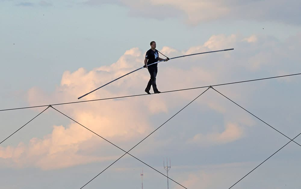 High-wire daredevil Nik Wallenda walks a tightrope above the Milwaukee Mile Speedway at the Wisconsin State Fair in West Allis, Wis.