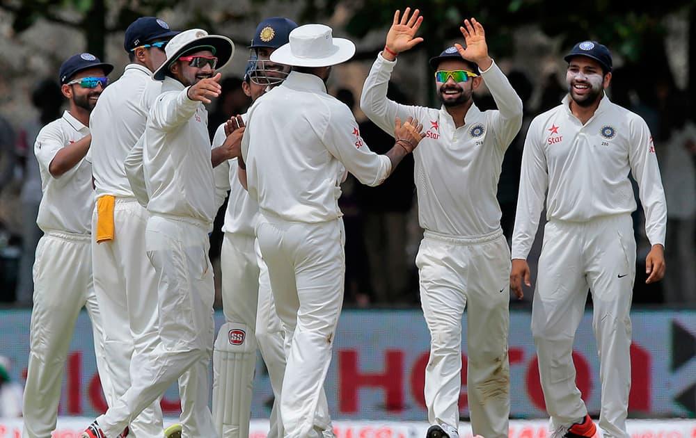 Virat Kohli, celebrates with teammates the dismissal of Sri Lanka's Kaushal Silva their first cricket test match in Galle, Sri Lanka.