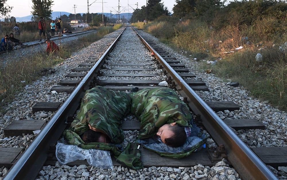 Syrian refugees sleep on railway lines near the train station of Idomeni, northern Greece.