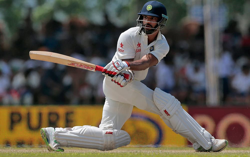 Shikar Dhawan plays a shot during the second day of their first test cricket match against Sri Lanka in Galle, Sri Lanka.