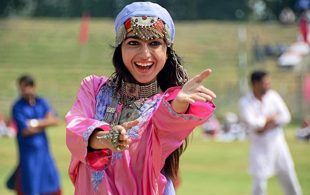 A College girl performs during the full dress rehearsal for Independence Day at Bakhshi Stadium in Srinagar.