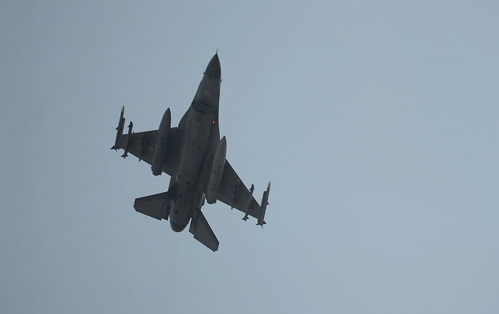 A Turkish Air Force fighter plane flies over the Incirlik Air Base, in Adana, southern Turkey.