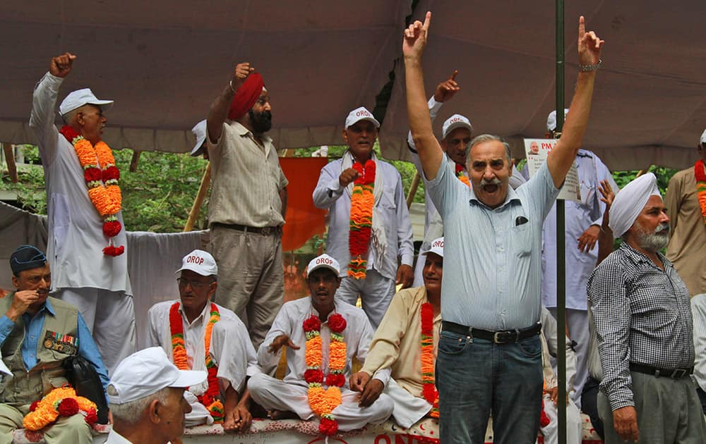 Ex-servicemen shout slogans at a protest in New Delhi. Former employees and officers of Indian defense forces have been protesting against what they call a discriminatory pension policy under the 'One Rank One Pension' banner.