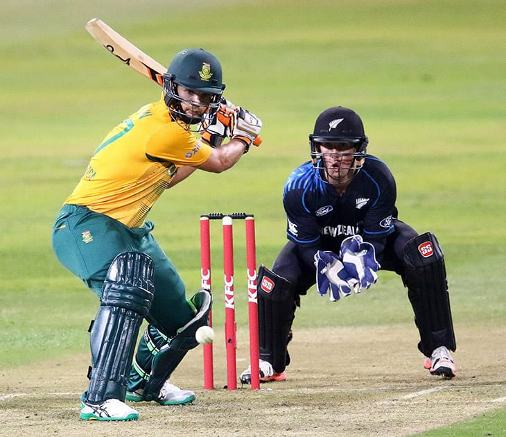 South Africa's Rillee Russouw bats with New Zealand's Luk Eronchi during their T20 cricket match between in Durban, South Africa