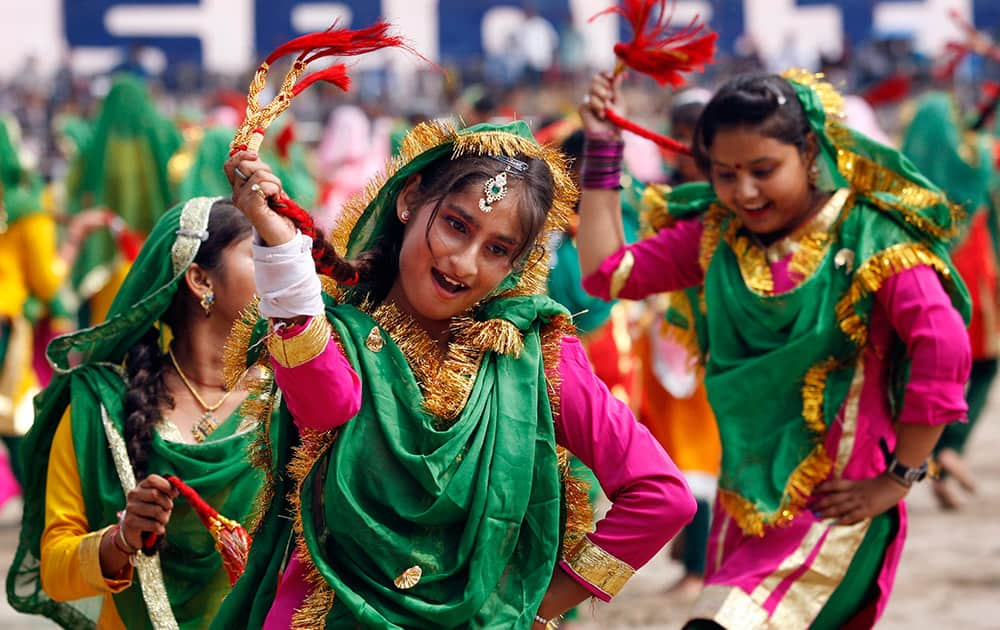 School girls, dressed in traditional attire, perform on the occasion of 69th anniversary of India's independence, in Jammu.