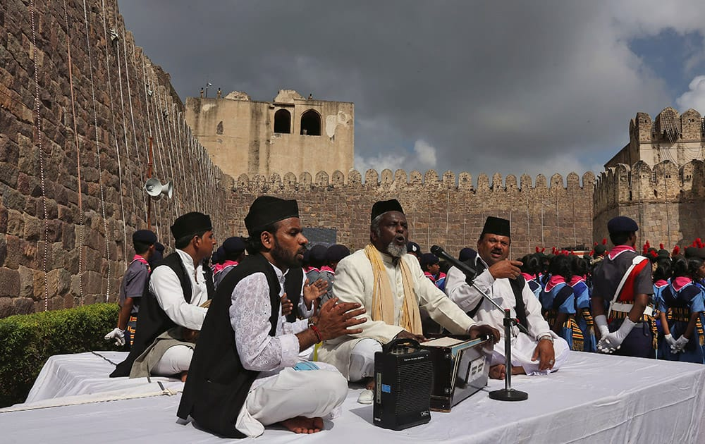 Artists sing as they perform during the 69th Independence Day celebrations at Golconda Fort in Hyderabad.