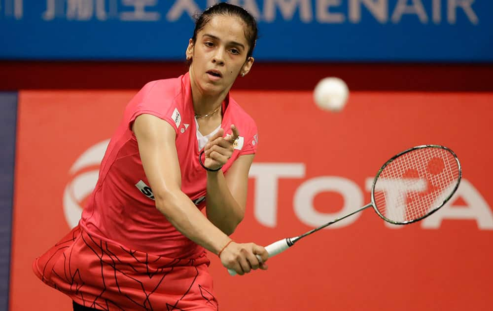 Saina Nehwal makes a forehand return to Indonesia's Lindaweni Fanetri during their women's singles semifinal match at the Badminton World Federation championships at Istora Stadium in Jakarta, Indonesia.