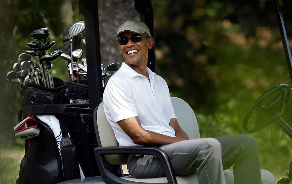 President Barack Obama smiles as he sits in a cart while golfing at Farm Neck Golf Club, in Oak Bluffs, Mass., on the island of Martha's Vineyard.