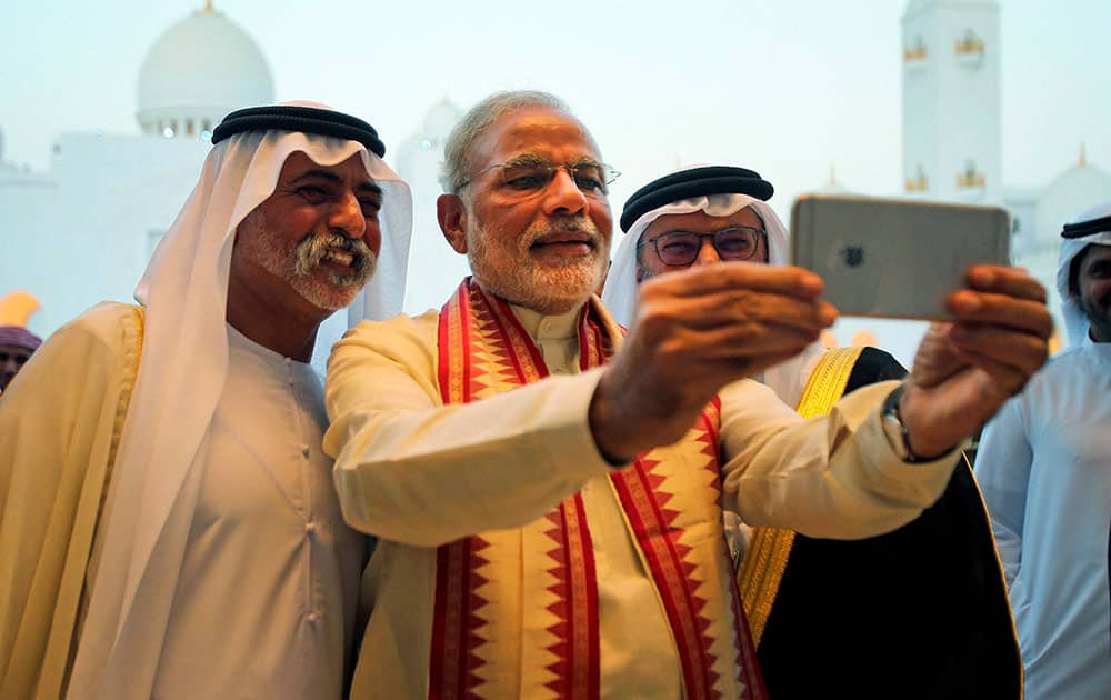 Prime Minister Narendra Modi takes a selfie with Sheikh Hamdan bin Mubarak Al Nahyan, UAE Minister of Higher Education and Scientific Research, during his visit to the Sheikh Zayed Grand Mosque on the first day of his two-day visit to the UAE, in Abu Dhabi, United Arab Emirates.