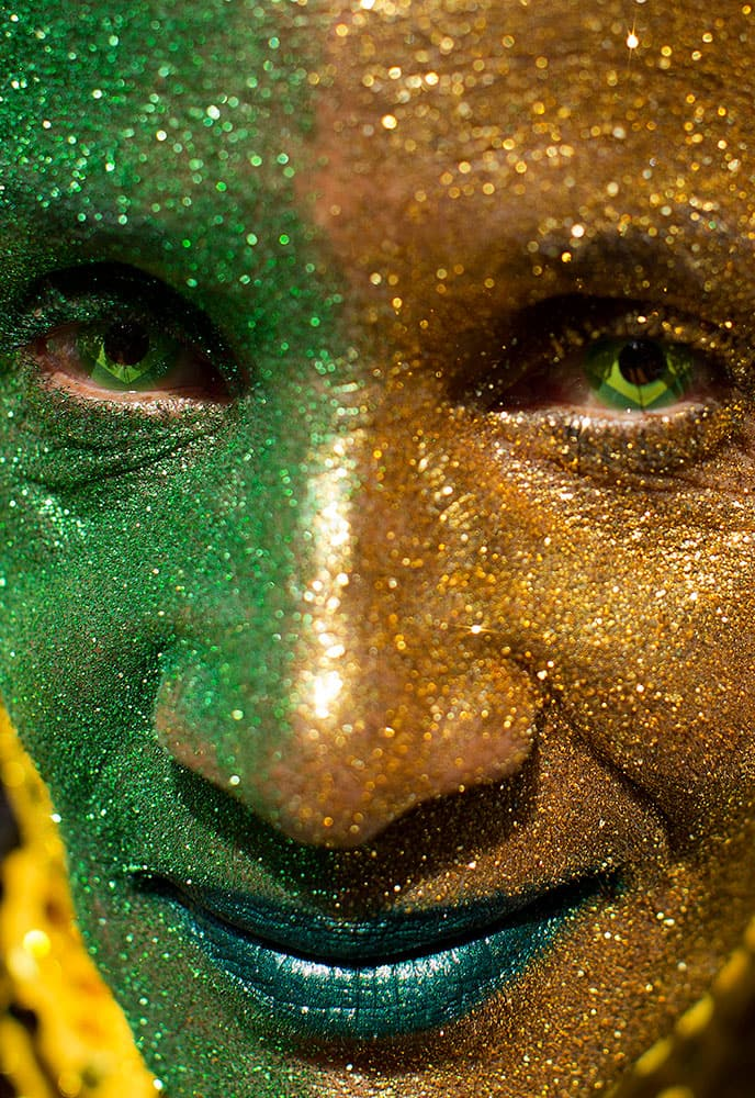 A demonstrator wearign contact lenses and with his face painted with the colors of the Brazilian flag poses for a picture during a protest demanding the impeachment of Brazil's President Dilma Rousseff in Sao Paulo, Brazil.