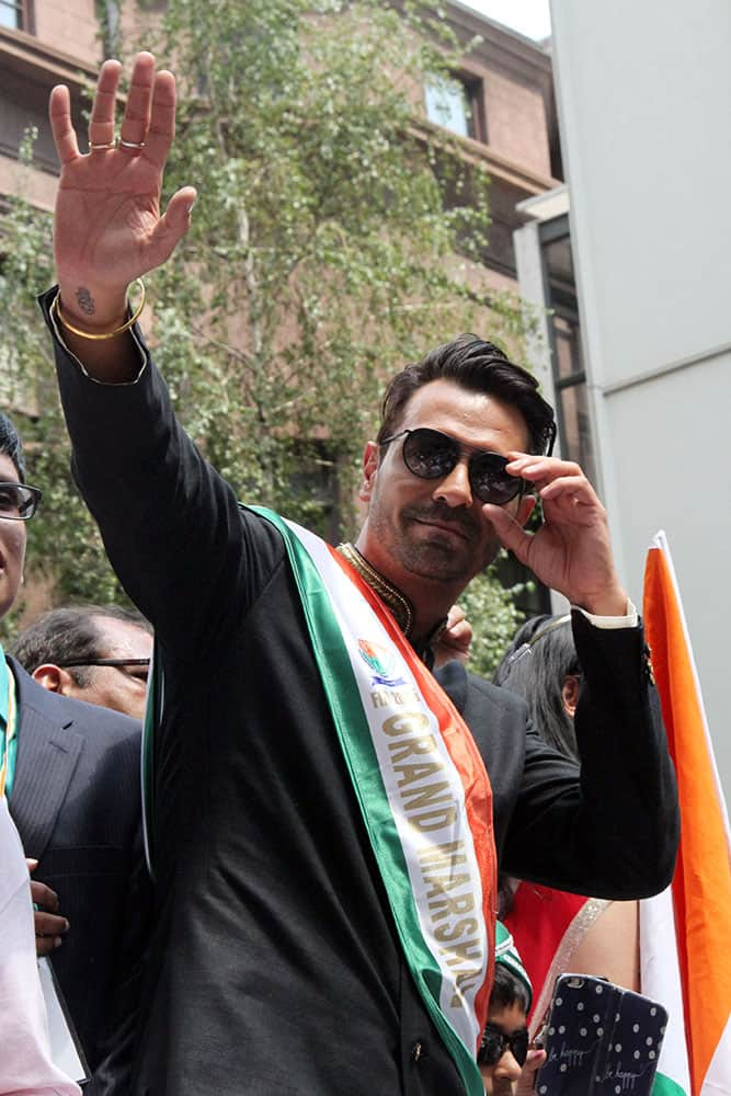Arjun Rampal waves to the crowd as he takes part in the India Day Parade along Madison Avenue in New York. Rampal was the parade's Grand Marshal.