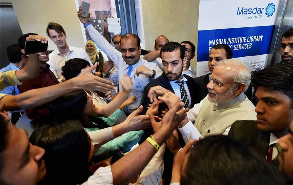 Prime Minister Narendra Modi greets people on his visit to Masdar city in Abu Dhabi, UAE.