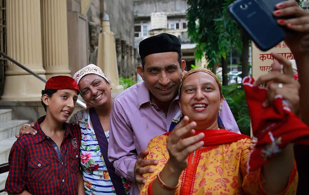 A Parsi family clicks a
