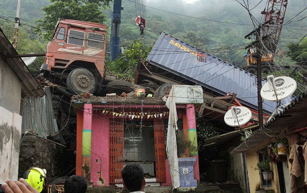 A huge container that fell over the slums at Mumbra Bypass in Thane, Mumbai during the wee hours of Tuesday.