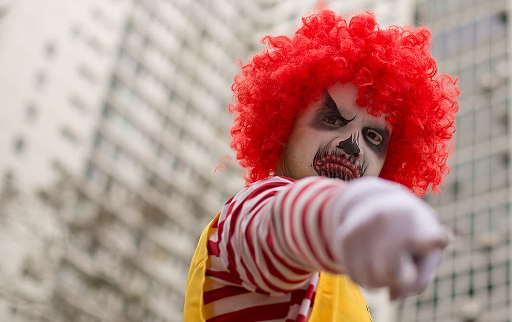 A demonstrator dressed as Ronald McDonald takes part in a protest for better wages and working conditions for McDonald's employees, in Sao Paulo, Brazil.