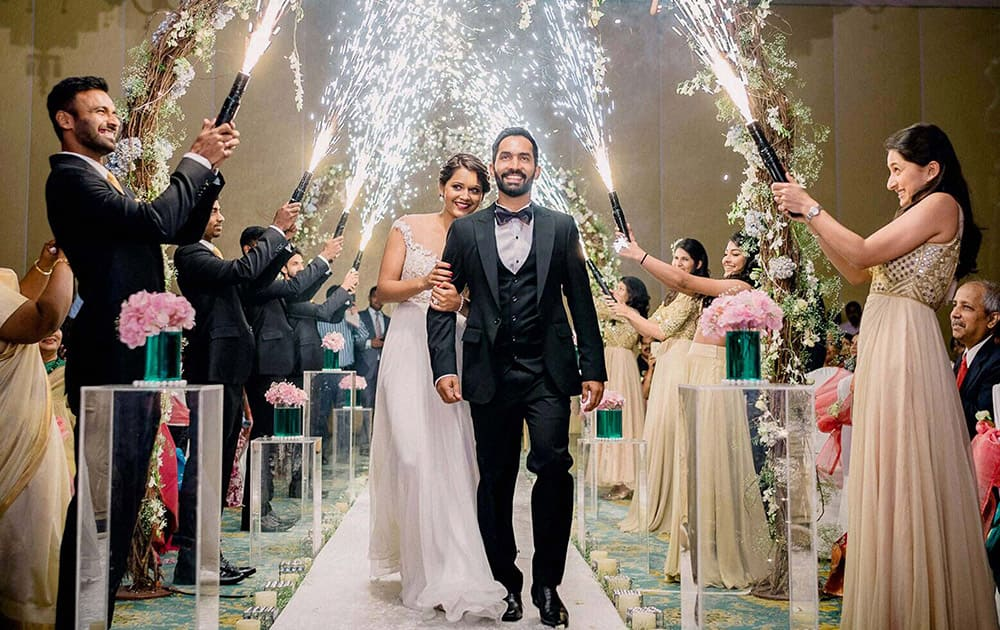 Cricketer Dinesh Karthik and ace squash player Deepika Pallikal during their wedding ceremony in Chennai.