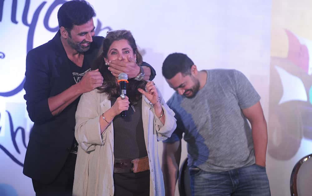 Akshay Kumar (L), Dimple Kapadia (C) and Aamir Khan (R) during the launch of Twinkle Khanna's book Mrs Funnybones at JW Marriot in Mumbai. -dna