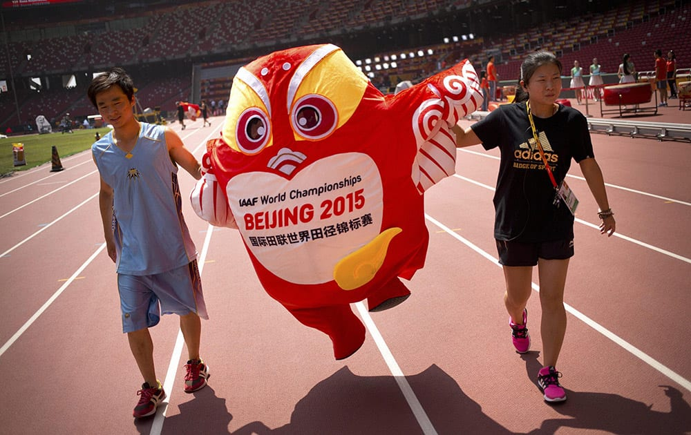 Staffers move a mascot for the World Athletics Championships along the track at the Beijing Olympic Stadium, also known as the Birds Nest, in Beijing.