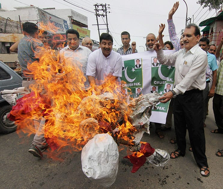 Activists of Jammu West Assembly Movement burn effigies during a protest against Pakistan in Jammu.