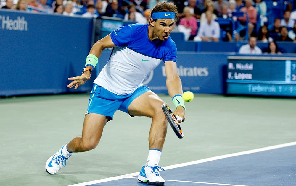 Rafael Nadal, of Spain, returns to Feliciano Lopez, of Spain, during a match at the Western & Southern Open tennis tournament, in Mason, Ohio. Lopez won 5-7, 6-4, 7-6 (3).