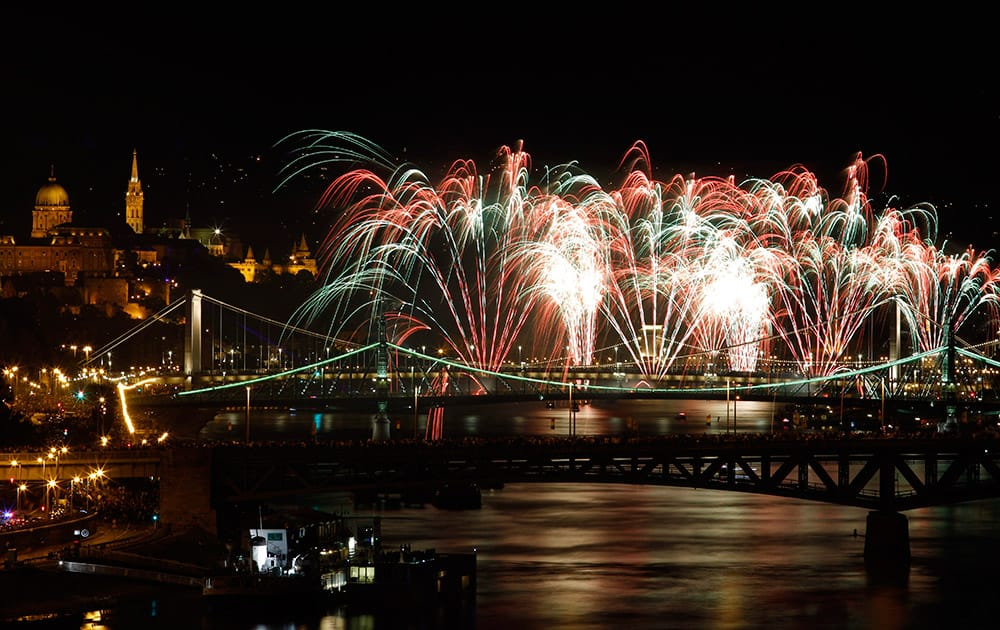 Fireworks explode above the River Danube as part of celebrations of the national holiday in central Budapest, Hungary.