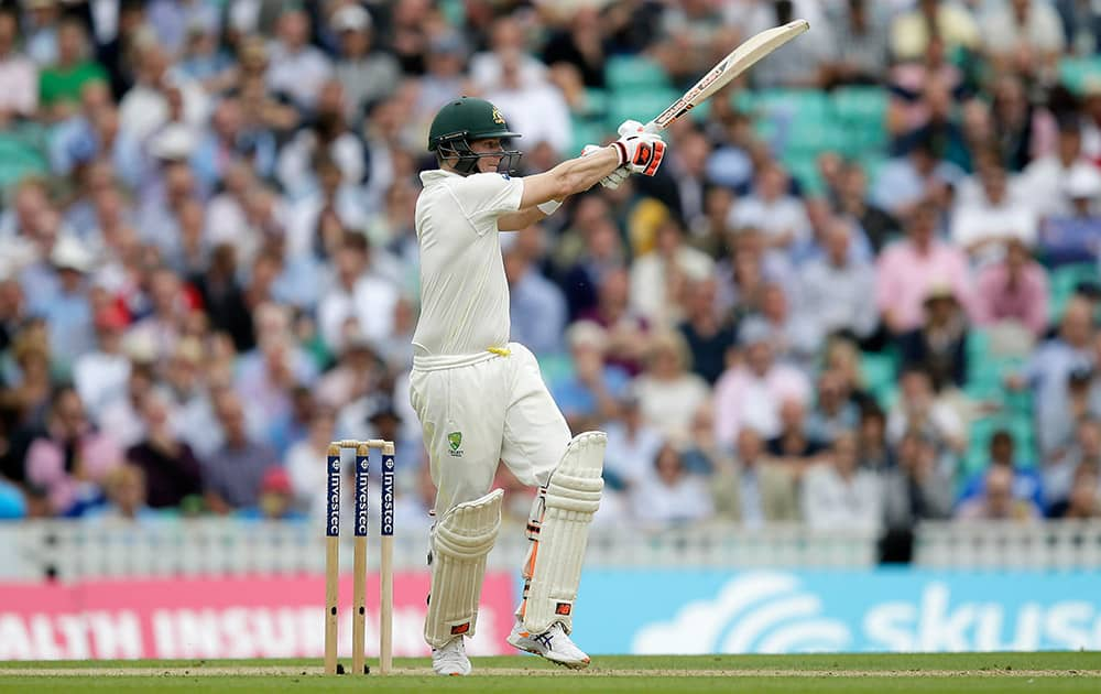Australia's Steven Smith plays a shot off the bowling of England's Stuart Broad on the first day of the fifth Ashes Test match between England and Australia, at the Oval cricket ground in London.