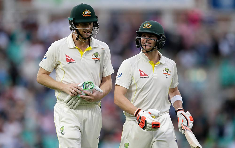 Australia's Adam Voges and Steven Smith leave the field at the end of play on the first day of the fifth Ashes Test match between England and Australia, at the Oval cricket ground in London.