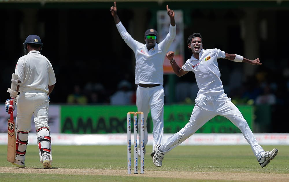 Sri Lanka's Dushmantha Chameera celebrates the dismissal of India's Amit Mishra during the second day's play play of their second test cricket match in Colombo, Sri Lanka.