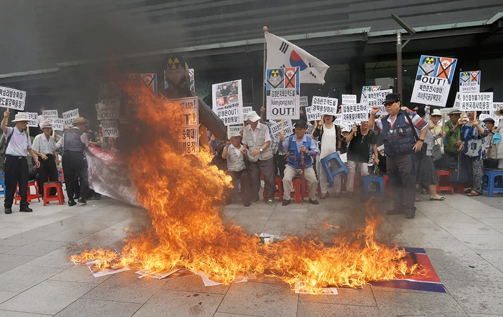 South Korean protesters burn an effigy of North Korean leader Kim Jong Un and a North Korean flag during an anti-North Korean rally in Seoul, South Korea.