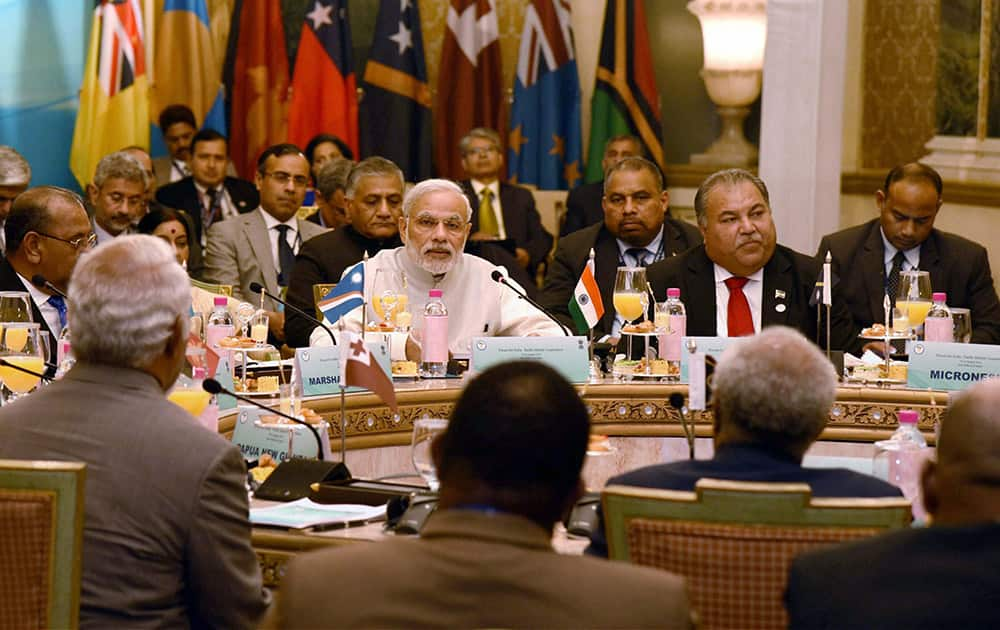 Prime Minister Narendra Modi chairing the round table meeting of the FIPIC Summit 2015, in Jaipur.