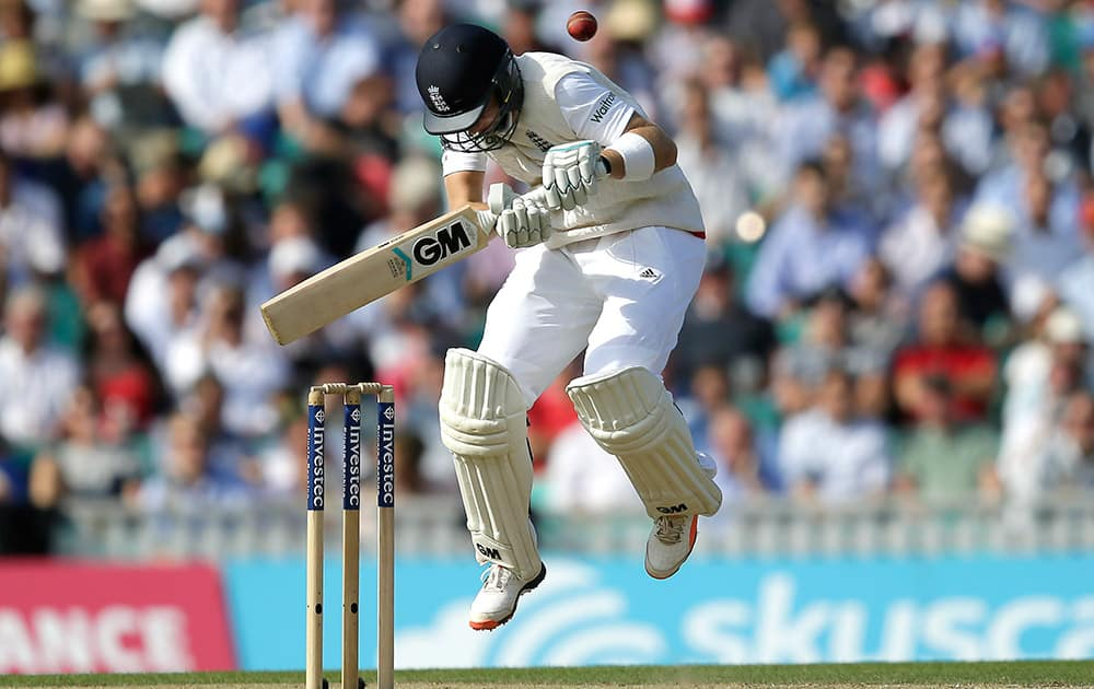 England's Joe Root tries to play a shot off the bowling of Australia's Mitchell Johnson on the second day of the fifth Ashes Test match between England and Australia, at the Oval cricket ground in London.