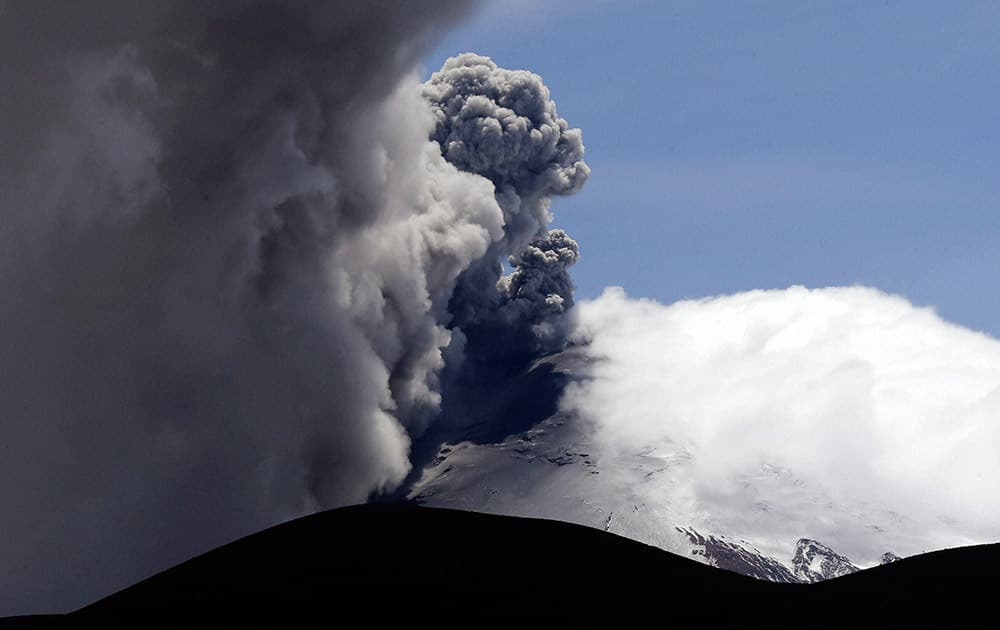 Ash and steam spew from the Cotopaxi volcano near Ticatilin, Ecuador.
