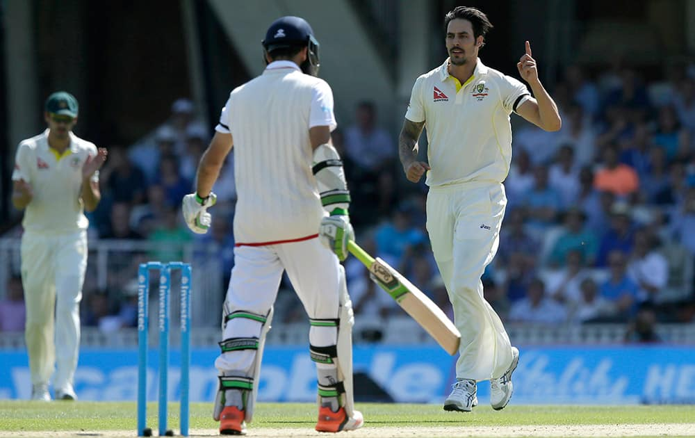 Australia's Mitchell Johnson celebrates taking the wicket of England's Moeen Ali on the third day of the fifth Ashes Test match between England and Australia, at the Oval cricket ground in London.