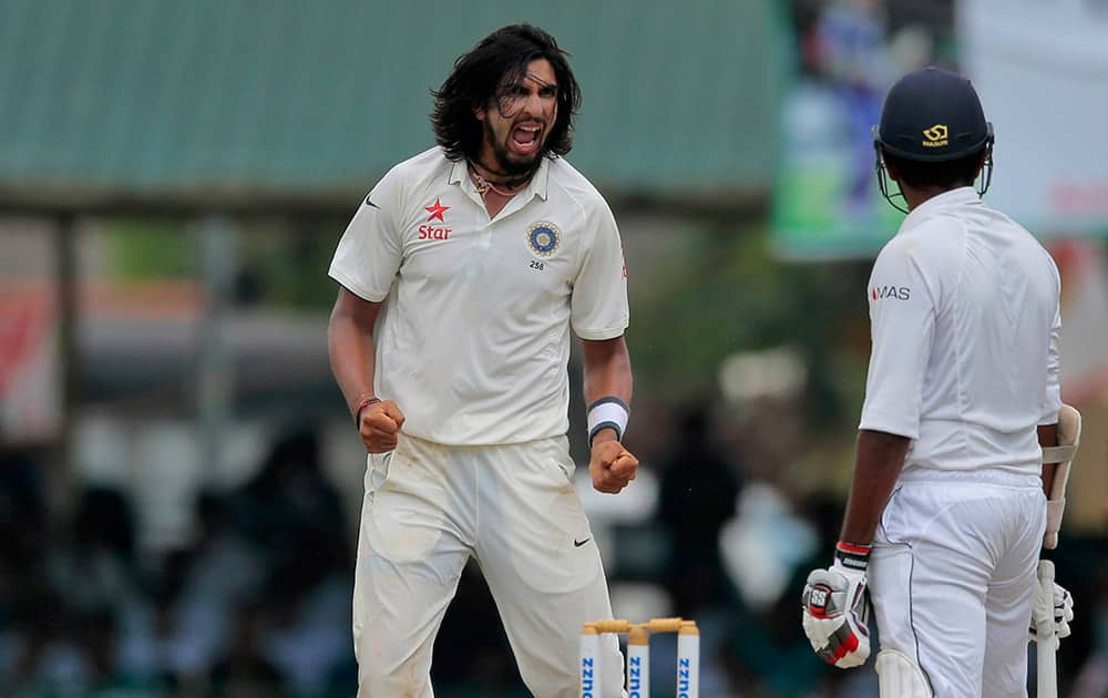 Ishant Sharma celebrates the dismissal of Sri Lanka's Lahiru Thirimanne during the third day's play of the second test cricket match between them in Colombo, Sri Lanka.