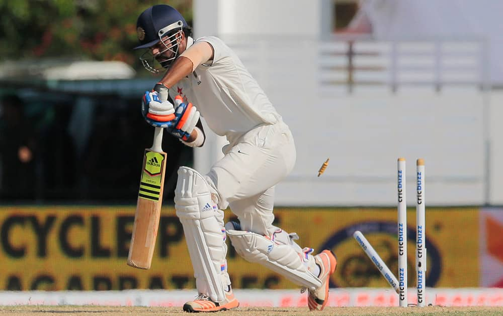 Lokesh Rahul bowls out off Sri Lanka's Dhammika Prasad, not pictured, during the third day's play of the second test cricket match between them in Colombo, Sri Lanka.