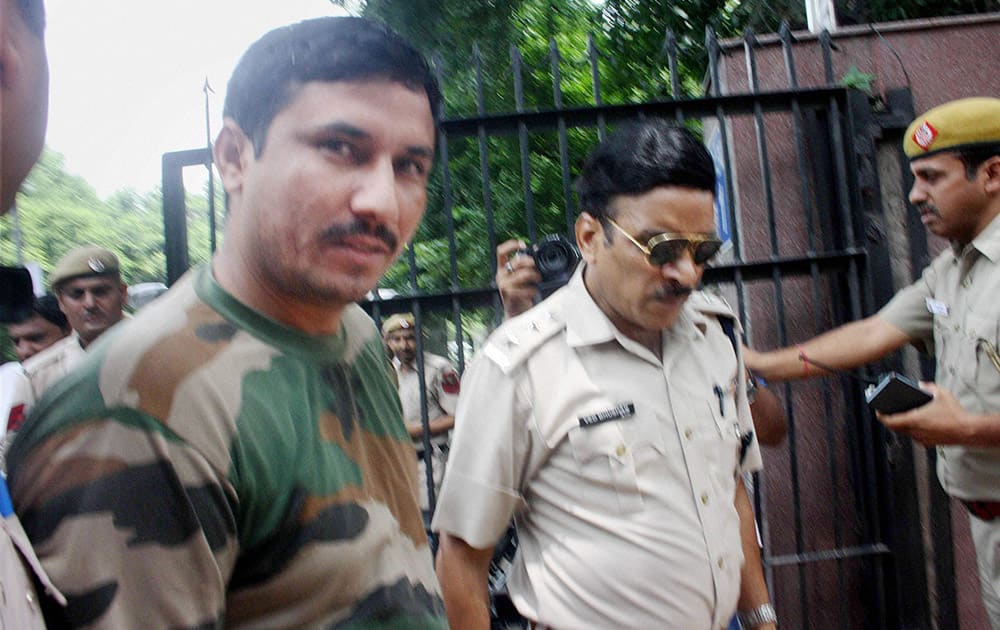 Aam Aadmi Party MLA Surender Singh Commando, arrested by the Delhi Police in a case of physical assault, being produced at Patiala House Court.